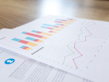 photot of a book with financial charts